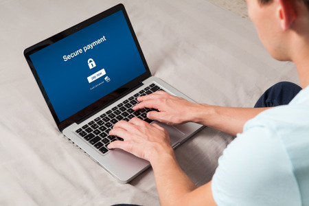 secure payment: Secure payment. Bank message in a laptop screen. Man typing on the keyboard.