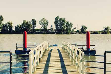 Vintage wooden pier by the river.