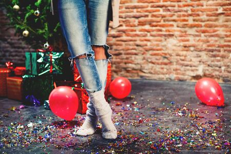 after party: Close up of woman legs standing on the floor after a christmas party. Stock Photo