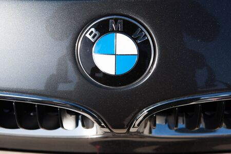 shiny car: MALAGA, SPAIN - DECEMBER 2, 2015: BMW car logo in the hood of car. Close up detail of BMW brand logo in a car. BMW is a German luxury automobile, motorcycle and engine manufacturing company founded in 1916.