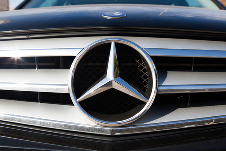 benz: MALAGA, SPAIN - DECEMBER 2, 2015: Mercedes Benz car logo in the front of car grid. Mercedes Benz is a German automobile manufacturer, a multinational division of the German manufacturer Daimler AG.