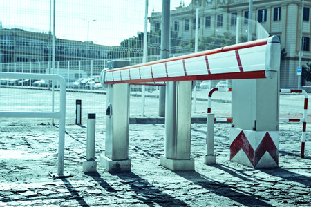 barrier: Access barrier for vehicles. Stock Photo