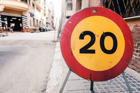 20 kmh speed limit sign on the walk side. Public road works. 스톡 사진