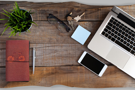 tablet devices: Smartphone, glasses, pen and computer over wooden table desk. Stock Photo