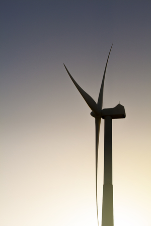 dark sky: Windmill shadow. Back lightning windmill power generator in a sunset sky background.