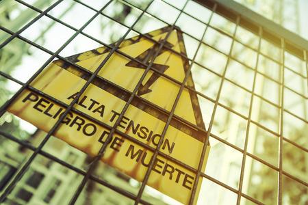 hazardous area sign: High voltage sign.