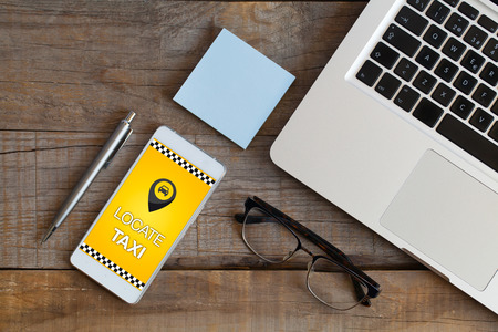 locating: Locating taxi app in a mobile phone screen. Stock Photo