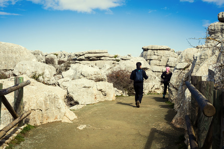 Visitors in El Torcal of Antequera. Andalusia, Spain.