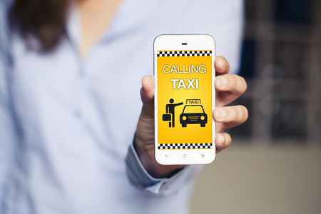 Taxi booking app in a mobile phone.