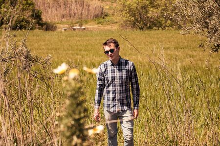 Rural portrait of man in sunglasses. Stock Photo