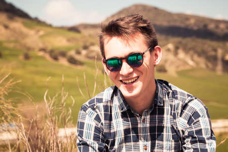 young man portrait: Smiling young man in sunglasses close up portrait.