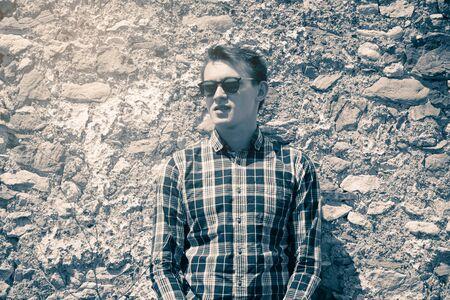 Vintage portrait of man in sunglasses. Stock Photo