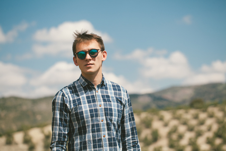 Young man in sunglasses in the Spanish countryside. Stock Photo