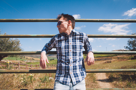 Man in a fence at the countryside.