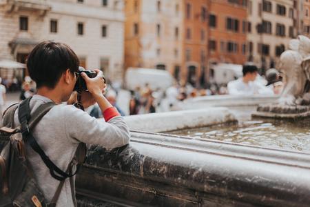 obelisk stone: Man taking photos in Rome. Stock Photo