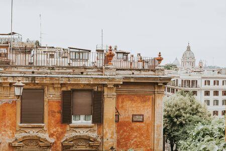 Classic Italian balcony and facade in Rome.