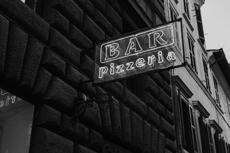 Vintage pizza neon lettering in Rome. Black and white. Stock Photo
