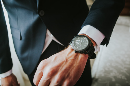 Brand new luxury watch in a man wrist. Business. Stock Photo