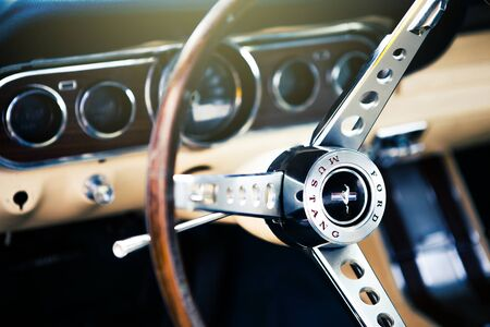 Benalmadena, Spain - June 21, 2015: Inside view of classic Ford Mustang, with focus on the steering wheel, in Benalmadena (Spain), on June 21, 2015. 新聞圖片