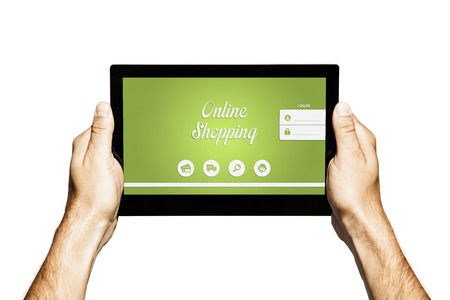 Hands holding a tablet with online shopping website in the screen. Stock Photo