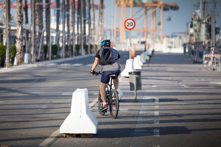 Man taking a ride in a mountain bike in a city road.