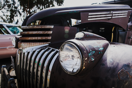 bad condition: Old car headlamp detail in bad condition. Stock Photo