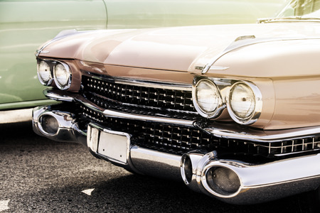 Vintage car front grid and headlamps. Stock Photo
