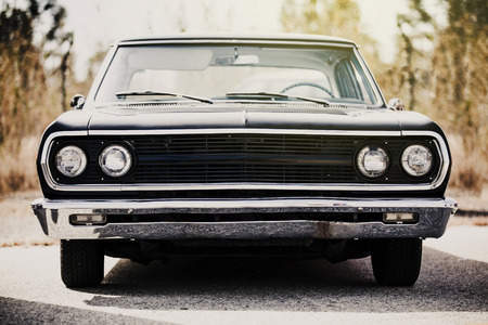 car grill: Black american classic car. Front view.