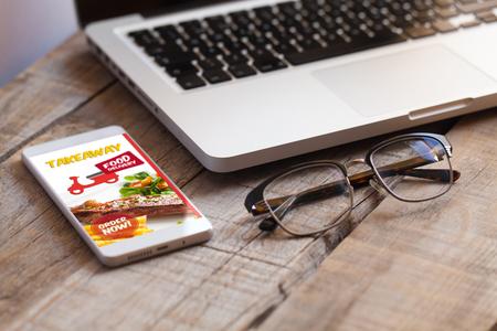 Take away restaurant mobile app in a smart phone screen. Standard-Bild