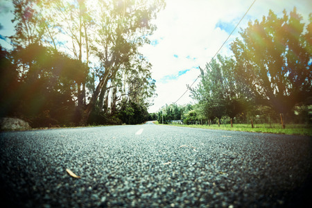 low perspective: Low angle view of straight road. Vintage style effect.
