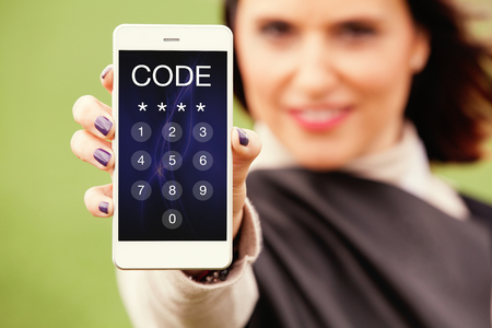 Woman showing mobile phone with passcode in the screen. Unlocking phone.