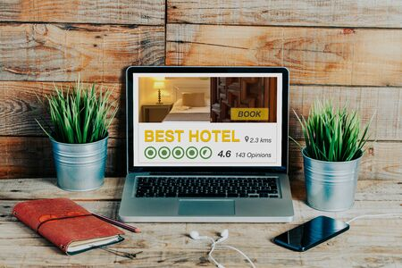 Booking hotel for holidays with a laptop computer 스톡 콘텐츠