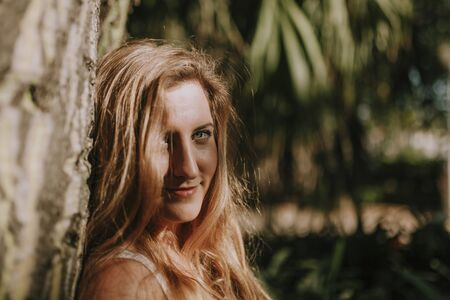 portrait of young blonde woman in the forest.