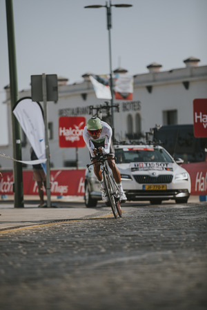 MALAGA, SPAIN - August 25th, 2018: Amanuel Ghebreigzabhier, from Dimension Data Cycling Team, during first stage of La Vuelta 2018 in the city of Malaga, Spain. Redactioneel
