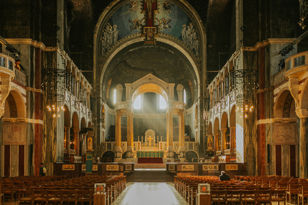 Westminster cathedral inside view, with sun light entering through windows.