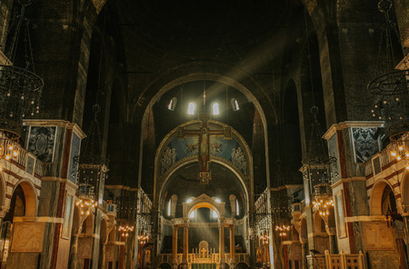 Westminster cathedral inside view, with sun light entering through windows. Editorial