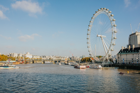 LONDON, ENGLAND - 25th, October 2018: River Thames viewed from Westminster Bridge in a sunny day, and London Eye in the background, in London, United Kingdom