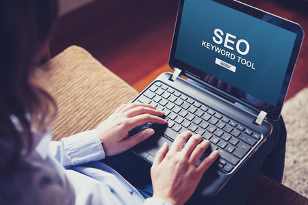Woman using a laptop computer to do SEO positioning in a website.