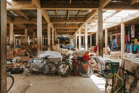 Rissani, Morocco - September 18th, 2019: Interior view of Rissani bazaar market, with a lot of bicycles parked, and the building structure visible, in Rissani, Morocco. Editorial