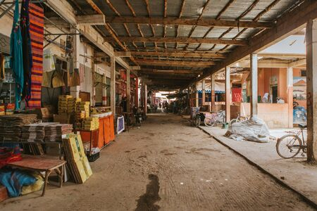 Rissani, Morocco - September 18th, 2019: Inside view of Rissani bazaar market, with stalls at both sides of a corridor, in Rissani, Morocco. Editorial