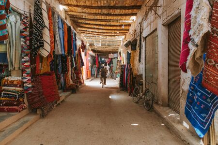 Rissani, Morocco - September 18th, 2019: Inside view of Rissani bazaar market, with stalls at both sides of a corridor, in Rissani, Morocco. 에디토리얼