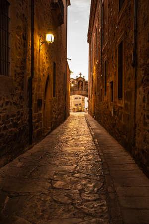Beautiful night view or Arco de la Estrella street, in the historic city of Caceres, Spain.