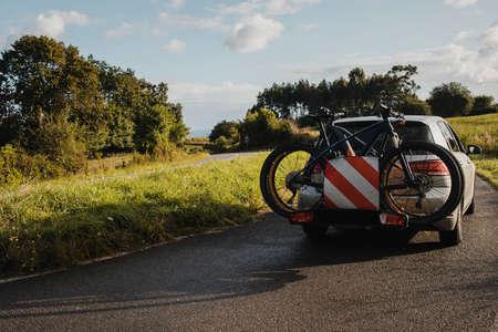 Mountain bikes on a car bike rack. Cycling vacations.