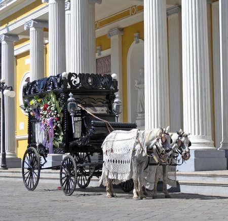 a old black hearse wagon