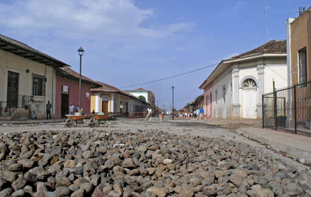 a road  with new cobble stone being laid photo