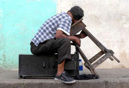 shoe shine man  at rest photo