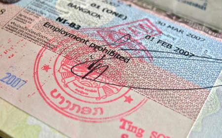 closeup of a lao visa in a british passport Фото со стока