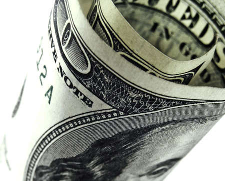 rolled up 100 dollar bill Stock Photo