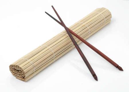 sushi mat and chopsticks photo