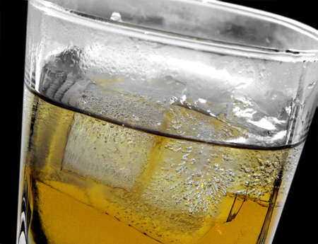 nightcap: amber drink with ice